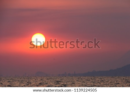 beautiful early pink dawn over a large lake in Mexico, big rising sun #1139224505