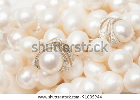 beautiful earrings made of silver with white pearl