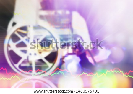 Beautiful effect blurry image of disable person sit on wheelchair with bright and colorful bokeh of light for fight hope and move on background with vital sign.