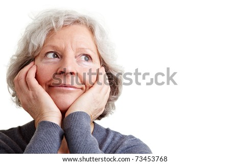 Beautiful elderly woman with grey hair daydreaming
