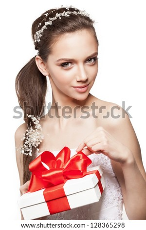 Beautiful elegance bride with small gift box