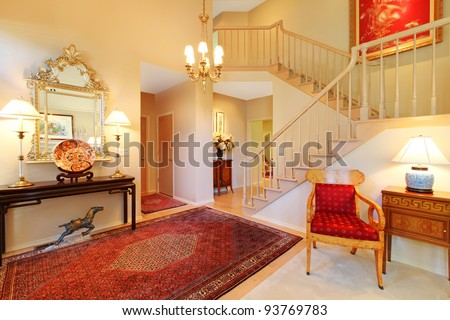 Beautiful elegant entrance, living room and stair case.