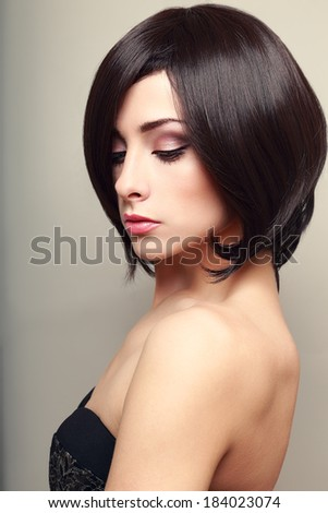 Beautiful elegant female model with black short hair