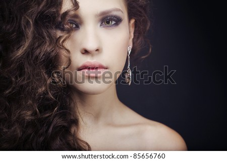 beautiful elegant girl with an evening make-up wearing jewelry