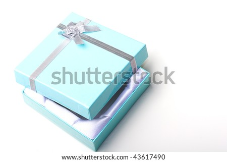 Beautiful elegant glossy blue empty jewelry gift box with silver ribbon with open top lid - stock photo
