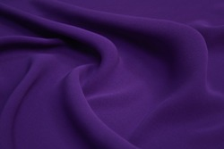 Beautiful elegant wavy violet purple satin silk luxury cloth fabric texture with violet background design.