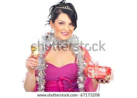 beautiful elegant woman celebrating Christmas and holding a present and a glass with champagne isolated on white background