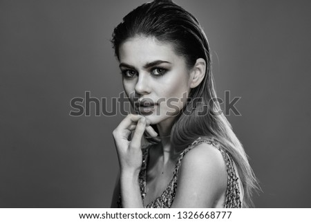 Beautiful elegant woman dress with make up on her face Black and white photo