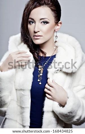 Beautiful elegant woman in a fur coat