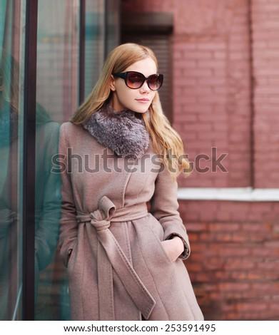 Beautiful elegant woman in coat outdoors