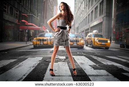 Beautiful elegant woman on a city street
