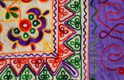 Beautiful embroidery multicoloured hand crafted thread work with mirrorwork from Kutch district bhuj called Kutchi embroidery. Embroidery work backdrop