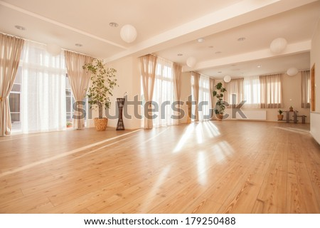 Beautiful empty naturally lit yoga studio