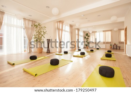 Beautiful, empty naturally lit yoga studio.