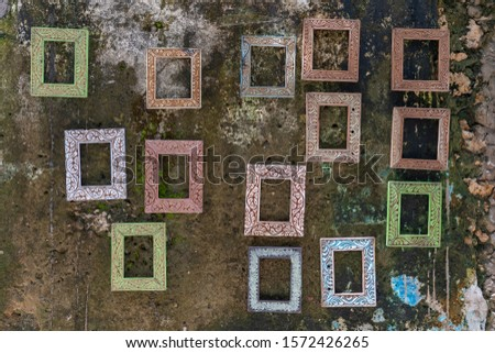 Beautiful empty picture frames hanging on the old wall on a street in Stone Town of Zanzibar Island, Tanzania, east Africa, close up