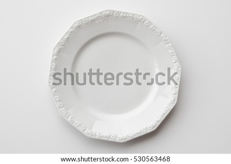 beautiful empty plate isolated on white background