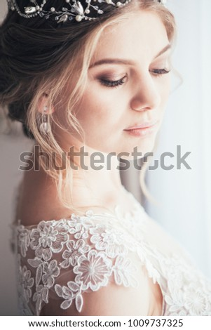beautiful enamored couple - bride and groom on wedding day in summer #1009737325