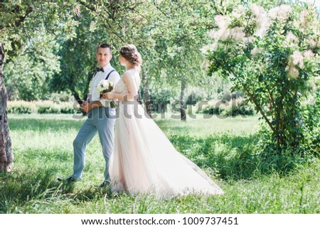 beautiful enamored couple - bride and groom on wedding day in summer #1009737451
