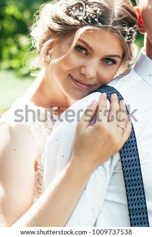 beautiful enamored couple - bride and groom on wedding day in summer #1009737538