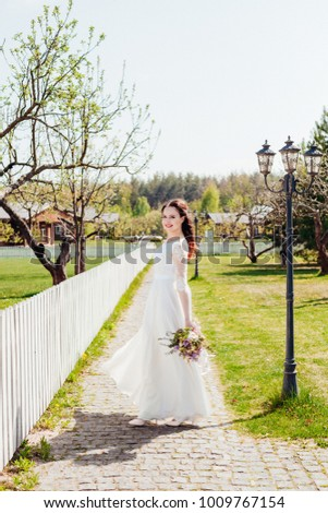 beautiful enamored couple - bride and groom on wedding day in summer #1009767154