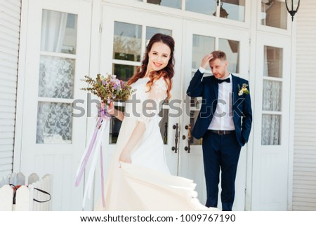 beautiful enamored couple - bride and groom on wedding day in summer #1009767190