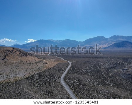 Beautiful endless desert road with mountains background #1203543481