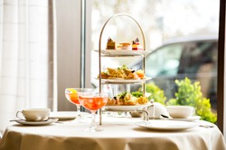 Beautiful english afternoon tea ceremony with desserts and snacks