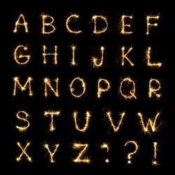 Beautiful english alphabet. Burning sparkler letters isolated on black background. Shiny festive font of Sparklers to overlay on texture for design Holiday postcards, web banners
