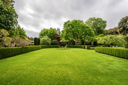 Beautiful English style garden with hedges, & symmetrical type design, with a large open green lawn for parties & open air activities. The garden is designed with European flair, class and tradition.