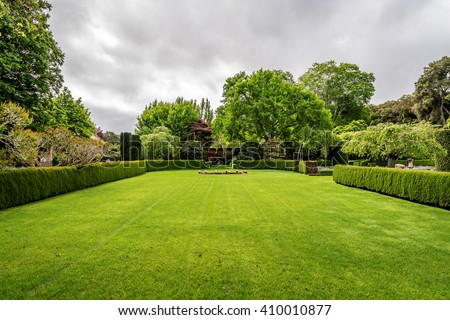 Beautiful English style garden with hedges, & symmetrical type design, with a large open green lawn for parties & open air activities. The garden is designed with European flair, class and tradition. #410010877
