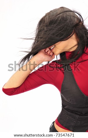 Beautiful European young woman dancing against white background