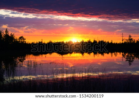 Beautiful evening landscape. Beautiful evening landscape. Colorful sunset. Bright sunset sky is reflected in the water of the lake. #1534200119