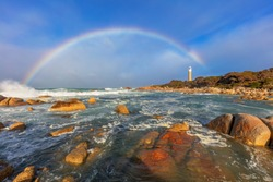 Beautiful evening light and rainbow over. Eddystone  point Lighthouse.Mount William National Park. Bay of Fires Conservation Area. North East Coast of Tasmania, Australia.
