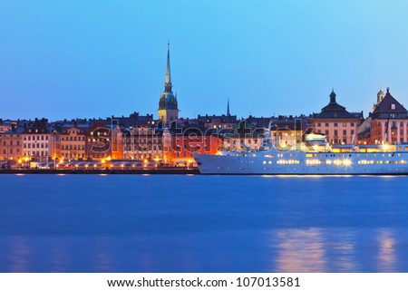 Beautiful evening scenery of the Old Town (Gamla Stan) pier and skyline in Stockholm, Sweden