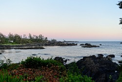 Beautiful evening seascape views of the rocky shoreline on the outside coast of Ucluelet facing the Pacific Ocean.