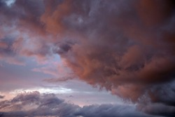 Beautiful evening sky with multi-colored bright clouds. Rain clouds at sunset