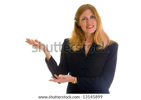 Beautiful executive business woman in navy blue business suit pointing and gesturing toward her right