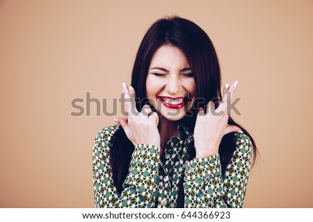 Beautiful exited lucky young woman studio portrait.