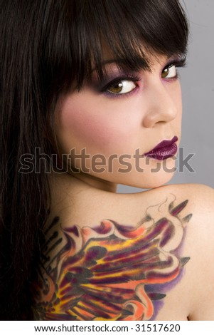stock photo Beautiful exotic woman with colorful tattoo
