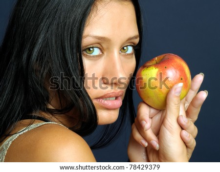 Beautiful exotic woman wjith apple