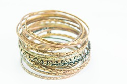 Beautiful expensive gold bracelets and ring on white background