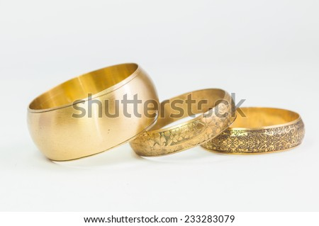 Beautiful expensive gold bracelets on white background