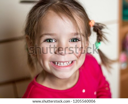 Beautiful expressive adorable happy cute laughing smiling baby infant toddler girl with horse tail showing teeth. Surprise. Emotion of joy, emotion of delight, emotion of surprise #1205560006