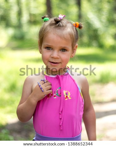Beautiful expressive adorable happy cute laughing smiling baby infant toddler girl with horse tail showing teeth. Surprise. Emotion of joy, emotion of delight, emotion of surprise #1388652344