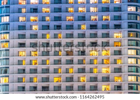 Beautiful exterior building and architecture of building with window and light pattern at night #1164262495