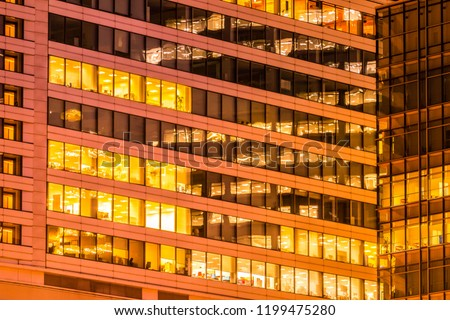 Beautiful exterior building and architecture of building with window and light pattern at night #1199475280