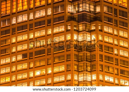 Beautiful exterior building and architecture of building with window and light pattern at night #1203724099
