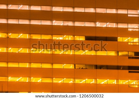 Beautiful exterior building and architecture of building with window and light pattern at night #1206500032