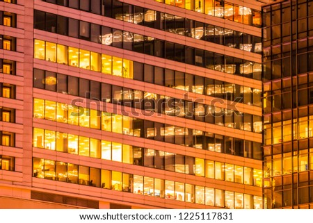 Beautiful exterior building and architecture of building with window and light pattern at night #1225117831