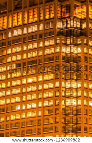 Beautiful exterior building and architecture of building with window and light pattern at night #1236909862